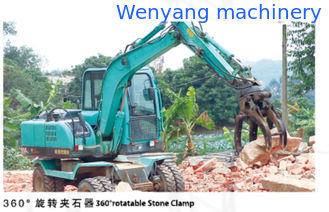 China 360 degree 4 wheel drive wheel excavator with 360 degree rotatable stone clamp supplier